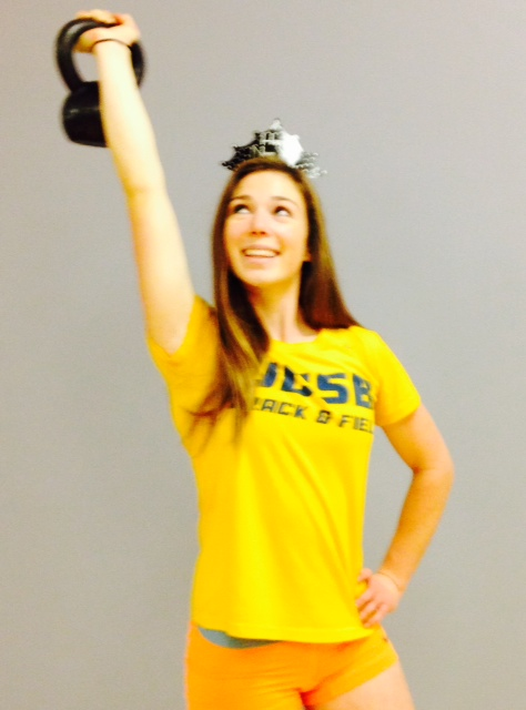 Model Katie Lee holds a kettle bell pondering her New years Resolution.